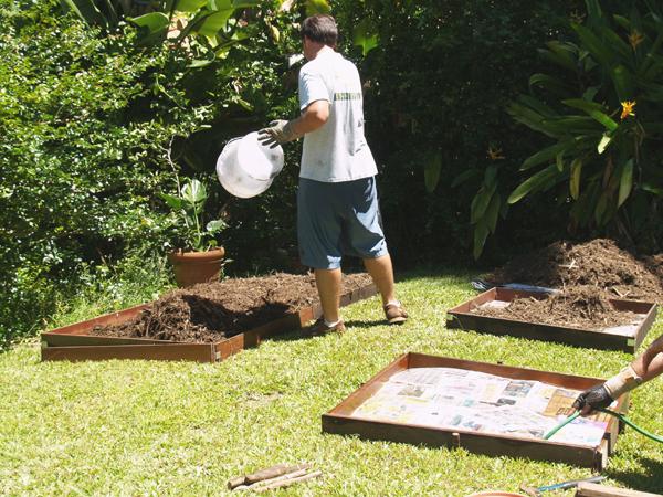 Colin spreading mulch