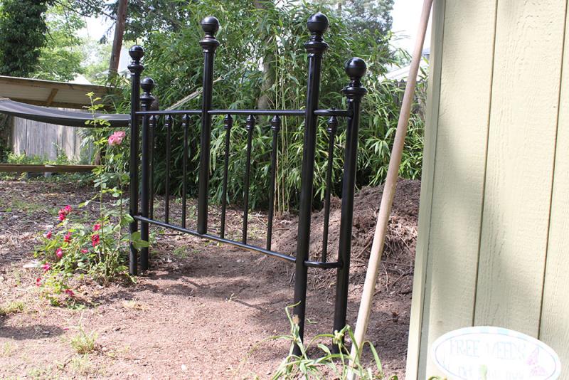 Repurpose_an_old_headboard_into_a_garden_fencel